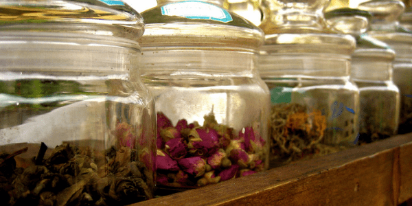 Jars of dried flowers and herbs, photo by Alexandra Moss